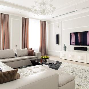Свежая идея для дизайна: открытая гостиная комната в современном стиле с серыми стенами, светлым паркетным полом, телевизором на стене и бежевым полом - отличное фото интерьера