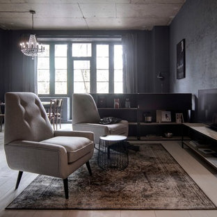 小さいインダストリアルスタイルのおしゃれなLDK (ライブラリー、塗装フローリング、据え置き型テレビ、白い床、黒い壁) の写真