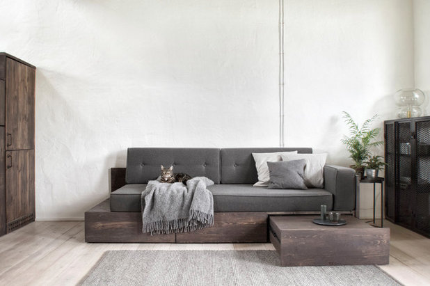 Industrial Living Room by INT2architecture