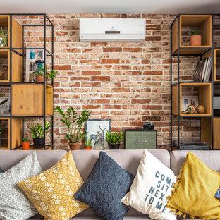 На фото: открытая, парадная гостиная комната среднего размера в скандинавском стиле с телевизором на стене и коричневыми стенами