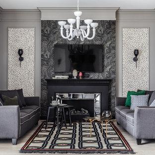 На фото: гостиные комнаты в стиле современная классика с светлым паркетным полом, телевизором на стене, бежевым полом, разноцветными стенами и стандартным камином