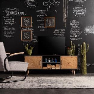 Свежая идея для дизайна: гостиная комната в стиле лофт с черными стенами - отличное фото интерьера