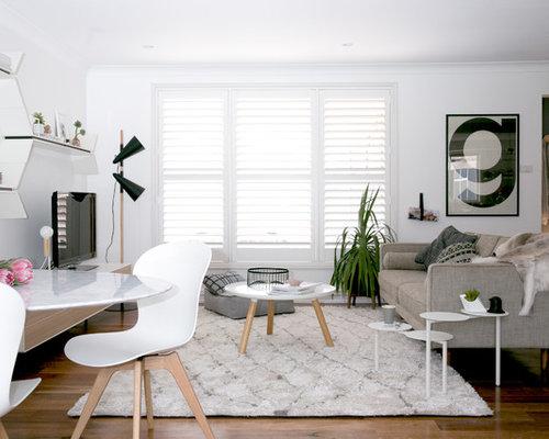 salle de s jour scandinave avec un sol en bois fonc photos et id es d co de salles de s jour. Black Bedroom Furniture Sets. Home Design Ideas