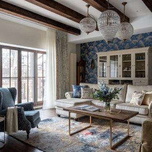 На фото: гостиная комната в стиле современная классика с синими стенами, темным паркетным полом, коричневым полом, балками на потолке и обоями на стенах
