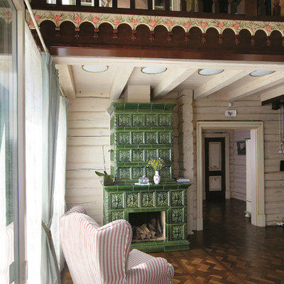 Inspiration for a mid-sized country formal and open concept dark wood floor living room remodel in Other with a standard fireplace, a tile fireplace and white walls
