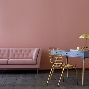 This is an example of a scandinavian enclosed living room in Moscow with pink walls and black floors.