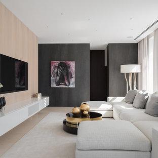 Стильный дизайн: парадная гостиная комната в современном стиле с мультимедийным центром и бежевым полом - последний тренд