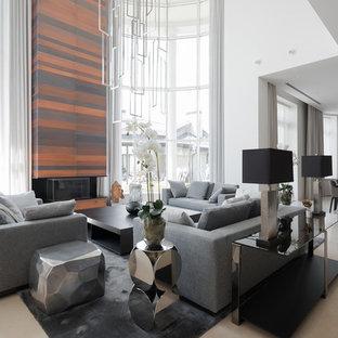 Пример оригинального дизайна интерьера: парадная, открытая гостиная комната в современном стиле с белыми стенами и бежевым полом