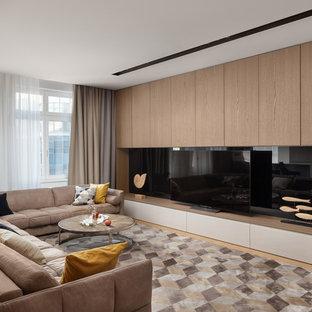 Свежая идея для дизайна: гостиная комната в современном стиле с отдельно стоящим ТВ и светлым паркетным полом без камина - отличное фото интерьера