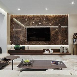 Idee per un grande soggiorno design aperto con angolo bar, pareti beige, pavimento in gres porcellanato, nessun camino, TV a parete e pavimento beige
