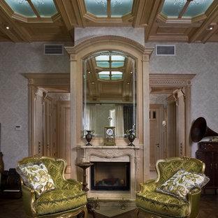 На фото: гостиные комнаты в викторианском стиле с паркетным полом среднего тона, камином и серыми стенами без ТВ