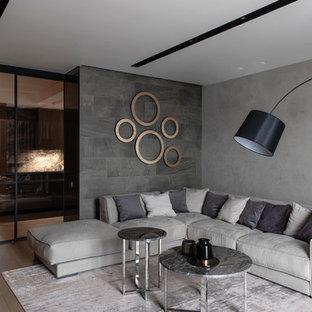 Свежая идея для дизайна: большая гостиная комната в современном стиле с серыми стенами и паркетным полом среднего тона - отличное фото интерьера