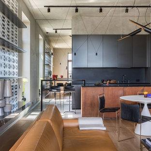Свежая идея для дизайна: парадная, открытая гостиная комната в стиле лофт с серыми стенами, паркетным полом среднего тона и коричневым полом - отличное фото интерьера