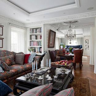На фото: парадные гостиные комнаты в стиле современная классика с белыми стенами, паркетным полом среднего тона, отдельно стоящим ТВ и коричневым полом