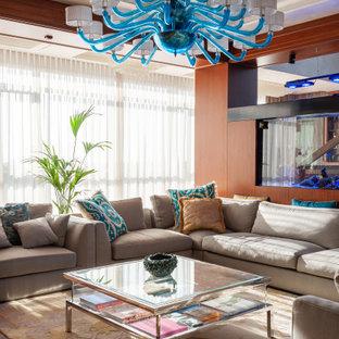 Свежая идея для дизайна: открытая гостиная комната в современном стиле с темным паркетным полом, телевизором на стене и коричневым полом - отличное фото интерьера