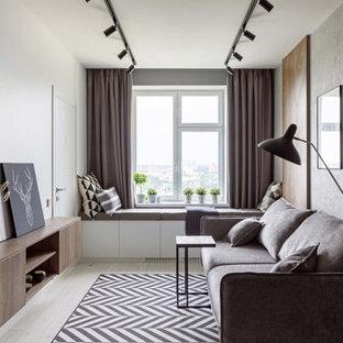 Стильный дизайн: гостиная комната в скандинавском стиле с белыми стенами и светлым паркетным полом без камина, ТВ - последний тренд