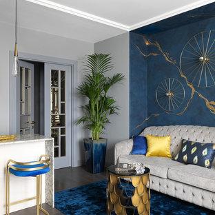 На фото: парадные, открытые гостиные комнаты в стиле современная классика с паркетным полом среднего тона, коричневым полом и синими стенами