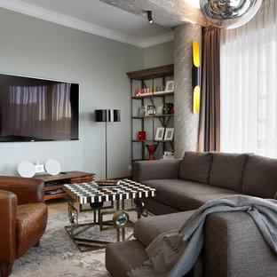 На фото: парадная гостиная комната в современном стиле с серыми стенами и телевизором на стене