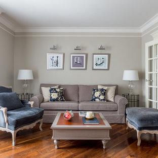 Стильный дизайн: парадная гостиная комната в стиле современная классика с серыми стенами, паркетным полом среднего тона и коричневым полом - последний тренд
