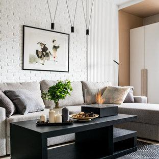 Неиссякаемый источник вдохновения для домашнего уюта: маленькая открытая гостиная комната в скандинавском стиле с белыми стенами