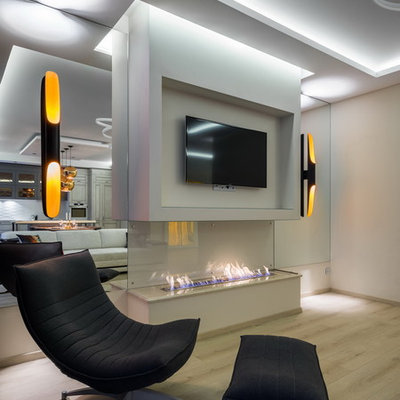 Example of a trendy formal and open concept living room design in Saint Petersburg with white walls, a ribbon fireplace and a wall-mounted tv