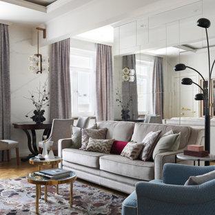 Inspiration för ett funkis vardagsrum, med vita väggar, mellanmörkt trägolv och brunt golv