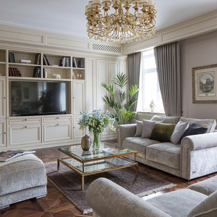 Inspiration for a traditional formal open concept living room in Moscow with beige walls, medium hardwood floors and a freestanding tv.