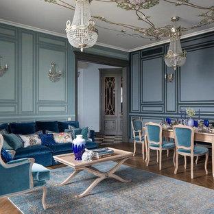 На фото: парадная гостиная комната в классическом стиле с синими стенами, паркетным полом среднего тона и коричневым полом с