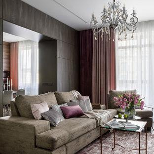 На фото: изолированная гостиная комната в современном стиле с разноцветными стенами, паркетным полом среднего тона, телевизором на стене, коричневым полом, многоуровневым потолком и панелями на части стены без камина