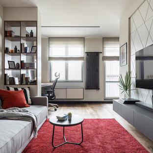Ejemplo de salón abierto y panelado, actual, panelado, sin chimenea, con paredes blancas, televisor colgado en la pared, suelo de madera en tonos medios y panelado