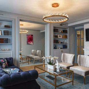 Идея дизайна: изолированная гостиная комната среднего размера в стиле современная классика с паркетным полом среднего тона, стандартным камином, телевизором на стене, коричневым полом и серыми стенами