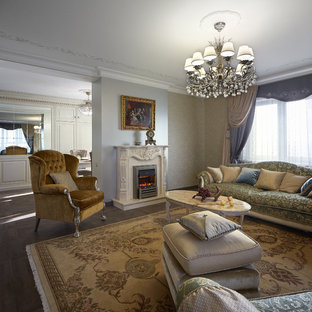 Inspiration for a mid-sized timeless formal and enclosed living room remodel in Yekaterinburg with gray walls, a standard fireplace and a stone fireplace