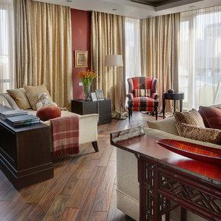 На фото: большая гостиная комната в стиле современная классика с красными стенами и темным паркетным полом с