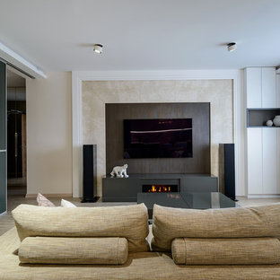 Photo of a medium sized contemporary open plan living room in Novosibirsk with beige walls, cork flooring, a ribbon fireplace, a wall mounted tv and beige floors.