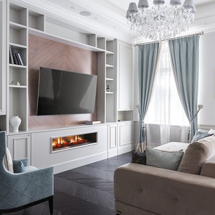 Inspiration for a traditional living room in Moscow with white walls, dark hardwood floors, a ribbon fireplace, a wall-mounted tv and brown floor.
