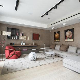 Medium sized modern living room in Saint Petersburg with beige walls, light hardwood flooring, a freestanding tv and beige floors.