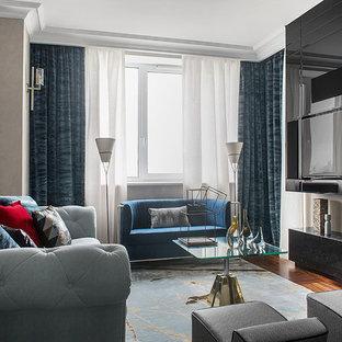 На фото: парадная гостиная комната среднего размера в стиле современная классика с серыми стенами, мультимедийным центром, паркетным полом среднего тона, горизонтальным камином и коричневым полом