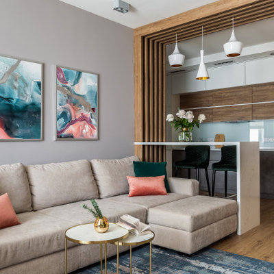 Living room - contemporary open concept medium tone wood floor and brown floor living room idea in Moscow with gray walls