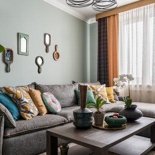 Свежая идея для дизайна: изолированная гостиная комната среднего размера в стиле фьюжн с серыми стенами - отличное фото интерьера