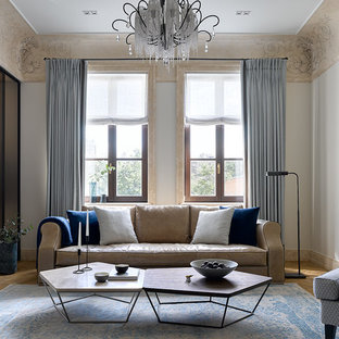 Свежая идея для дизайна: изолированная гостиная комната в стиле современная классика с белыми стенами, паркетным полом среднего тона и коричневым полом - отличное фото интерьера
