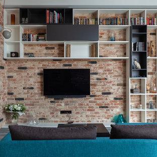 На фото: гостиная комната в стиле лофт с библиотекой, горизонтальным камином и телевизором на стене