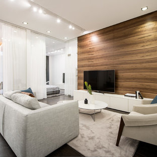 Design ideas for a contemporary living room in Moscow with brown walls, a freestanding tv and black floors.