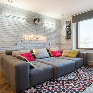 На фото: парадная, открытая гостиная комната среднего размера в стиле лофт с белыми стенами, паркетным полом среднего тона и коричневым полом с