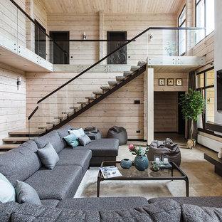 На фото: парадная гостиная комната в современном стиле с бежевыми стенами, стандартным камином, телевизором на стене и бежевым полом