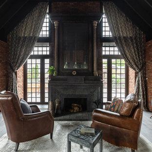 Свежая идея для дизайна: гостиная комната в стиле лофт с коричневыми стенами, стандартным камином и серым полом - отличное фото интерьера