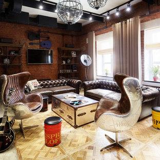 Foto di un grande soggiorno industriale stile loft con pareti rosse, pavimento in sughero e TV a parete