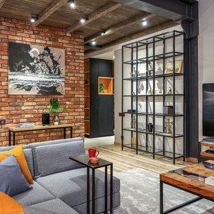 Свежая идея для дизайна: открытая гостиная комната в стиле лофт с белыми стенами, паркетным полом среднего тона, отдельно стоящим ТВ и коричневым полом - отличное фото интерьера