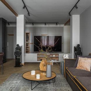 Идея дизайна: парадная, открытая гостиная комната среднего размера в современном стиле с серыми стенами, полом из винила, отдельно стоящим ТВ и желтым полом без камина