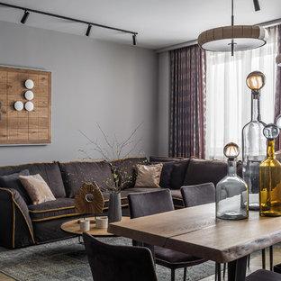 Exempel på ett mellanstort modernt allrum med öppen planlösning, med ett finrum, grå väggar, vinylgolv, en fristående TV och gult golv