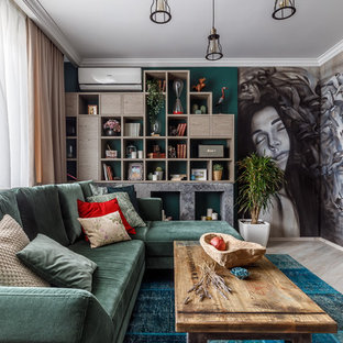 Inspiration for an eclectic living room in Other with green walls and beige floor.